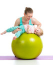 Mother and baby with gymnastic ball having fun Stock Image