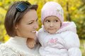 Mother with baby happy her daughter for a walk in the autumn Stock Image