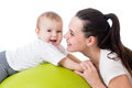 Mother and baby having fun on gymnastic ball fitness Stock Photo
