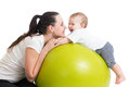 Mother and baby having fun her on gymnastic ball Royalty Free Stock Photo