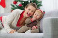 Mother and baby having fun time on Christmas Stock Photos