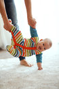 Mother with baby her playing on a carpet at home Stock Photography