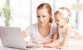 Mother and baby at home using laptop computer happy family Royalty Free Stock Photography