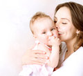 Mother and baby kissing hugging happy family Royalty Free Stock Photography