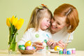 Mother and baby painting easter eggs Stock Image