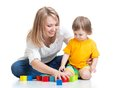 Mother and baby play with building blocks toy
