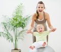 Mother and baby playing with fitness ball Royalty Free Stock Photography