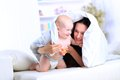 Mother and baby playing happy family smiling under a blanket Stock Photography