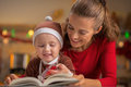 Mother and baby reading christmas book Royalty Free Stock Photo