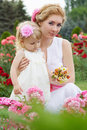 Mother and baby in rose garden Stock Image