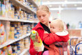 Mother with baby shopping in supermarket Stock Photography