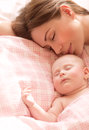 Mother with baby sleeping closeup portrait of child at home bedtime female newborn asleep health care happy motherhood Royalty Free Stock Photos