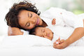 Mother baby sleeping cute african and in bed Royalty Free Stock Photography
