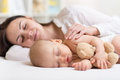 Mother and baby sleeping together in a bedroom her son Royalty Free Stock Photography