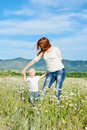 Mother and baby son in field are playing Royalty Free Stock Photography