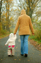 Mother and baby taking afternoon walk in the park Royalty Free Stock Photography