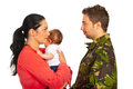 Mother with baby talk with military dad holding boy and talking her husband isolated on white background Stock Photography