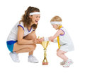 Mother and baby in tennis clothes with goblet medal Royalty Free Stock Photos