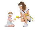 Mother and baby in tennis clothes playing isolated on white Stock Photos