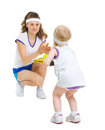 Mother and baby in tennis clothes playing tennis isolated on white Stock Photography