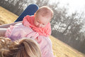 Mother and baby time on the grass daughter a sunny day in field Royalty Free Stock Photos