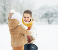 Mother and baby in winter park high resolution photo Stock Images