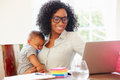 Mother With Baby Working In Office At Home Royalty Free Stock Photo