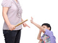 Mother being hit her son by ruler over white background Royalty Free Stock Photos