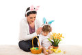 Mother and boy with easter basket put bunny ears to her son prepare a Stock Images