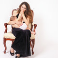 Mother breast feeding a cute baby. Newborn girl. Royalty Free Stock Photo