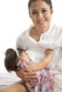 Mother is breast feeding for her baby on white background Stock Images