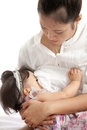 Mother is breast feeding for her baby on white background Stock Photography