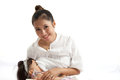 Mother is breast feeding for her baby on white background Royalty Free Stock Photos