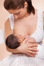 Mother breast feeding her child young Royalty Free Stock Photography
