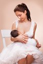 Mother breast feeding her child young Royalty Free Stock Images