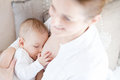 Mother breast feeding her infant Royalty Free Stock Photo