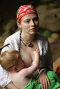 Mother breastfeeding child Stock Photos