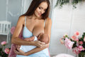 Mother breastfeeding her newborn child Royalty Free Stock Photo