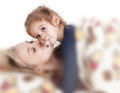 Mother brings her child to bed and tells a story Stock Image