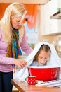 Mother care for sick child with vapor bath at domestic kitchen Royalty Free Stock Photography