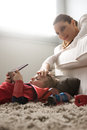 Mother caressing son s forehead lovely in the living room Stock Images