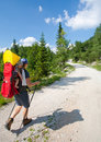 Mother carrying baby in alps Royalty Free Stock Photo