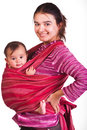 Mother carrying her baby in a sling Royalty Free Stock Photo