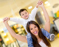 Mother carrying son her shoulders shopping center Stock Photography