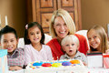Mother Celebrating Child's Birthday With Friends Royalty Free Stock Photography