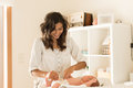 Mother changing baby`s diaper Royalty Free Stock Photo