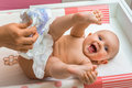 Mother changing diaper to her little baby girl Royalty Free Stock Photo