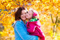 Mother and child in autumn park Royalty Free Stock Photo