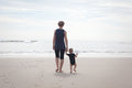 Mother and child on the beach hiking with a small Royalty Free Stock Photography