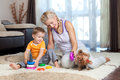 Mother, child boy and dog playing indoor Royalty Free Stock Photo
